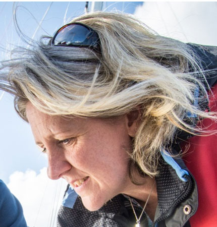 Head shot of Prof Liz Cottier Cook on fieldwork in a marina