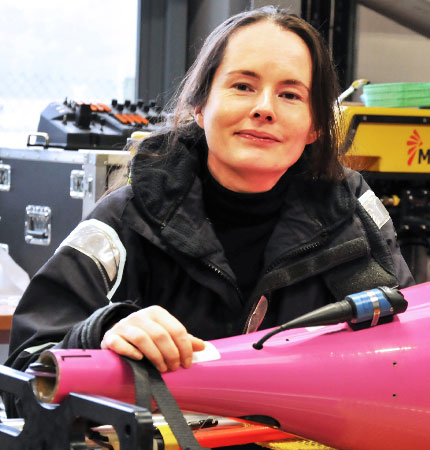 Marine robotics technician Estelle Dumont with a sea glider in the Scottish Marine Robotics Facility