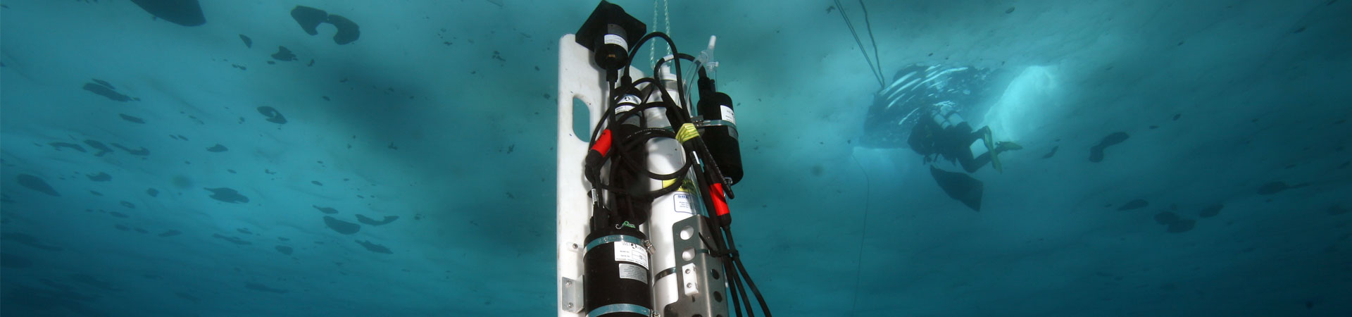A piece of marine technology dangling below the sea ice