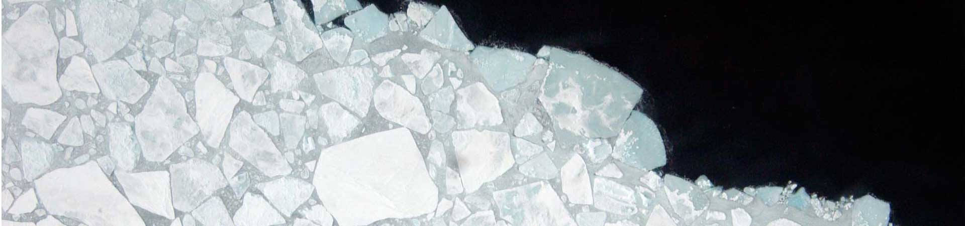 Drone footage of the margins of Arctic sea ice with water appearing black