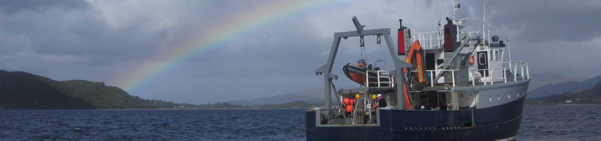 Image of SAMS research vessel with rainbow behind
