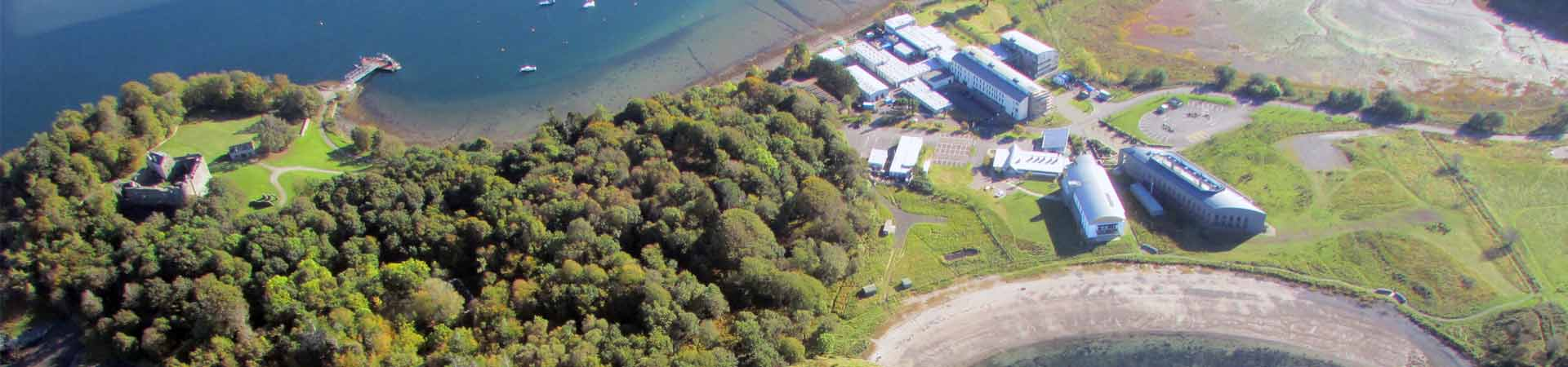 Aerial photograph of the Dunstaffnage peninsula with Dunstaffnage castle, SAMS, European Marine Science Park and SAMS' pontoon