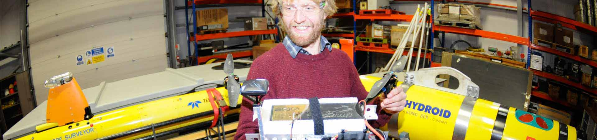 Technologist working on sensors for marine robots.