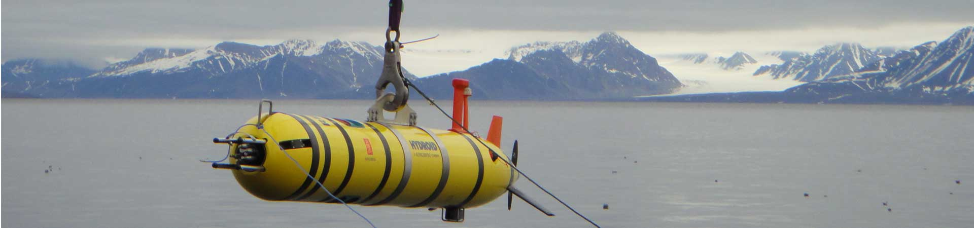 Picture shows an autonomous underwater vehicle being deployed into the Arctic Ocean