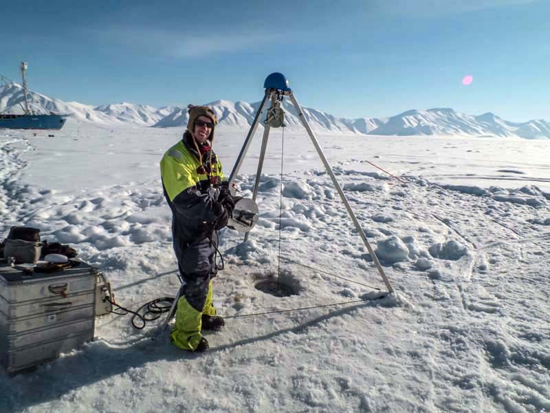 Jamie collects oceanographic data from below sea ice