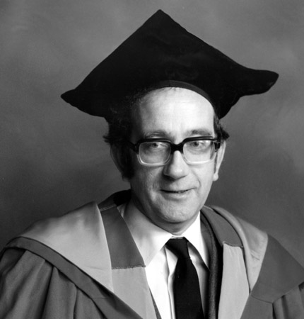 Black and white head and shoulder photo of the late SAMS biologist Alan Ansell in full academic robes