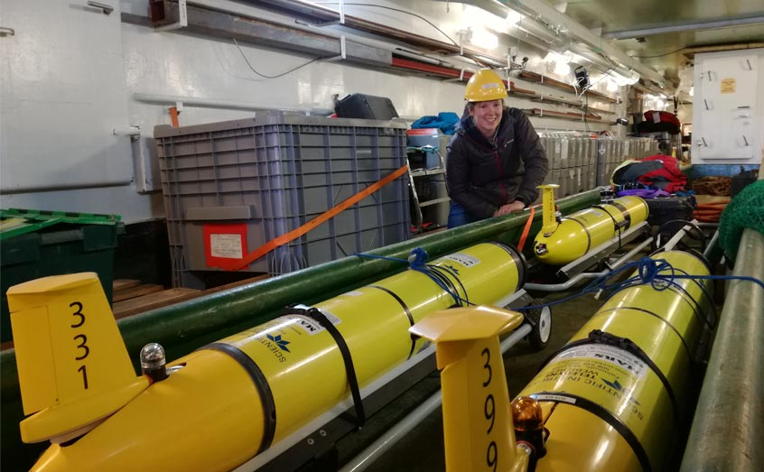Dr Marie Porter of SAMS with slocum gliders, one of which helped her uncover a hidden Arctic eddy. Photo: Dr Emily Venables/SAMS