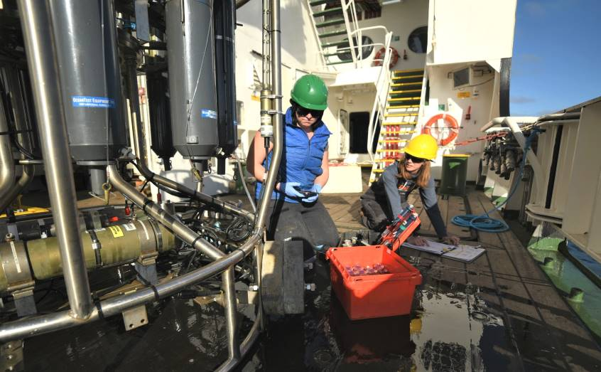SAMS scientists on board the RRS Discovery prepare a CTD for deployment