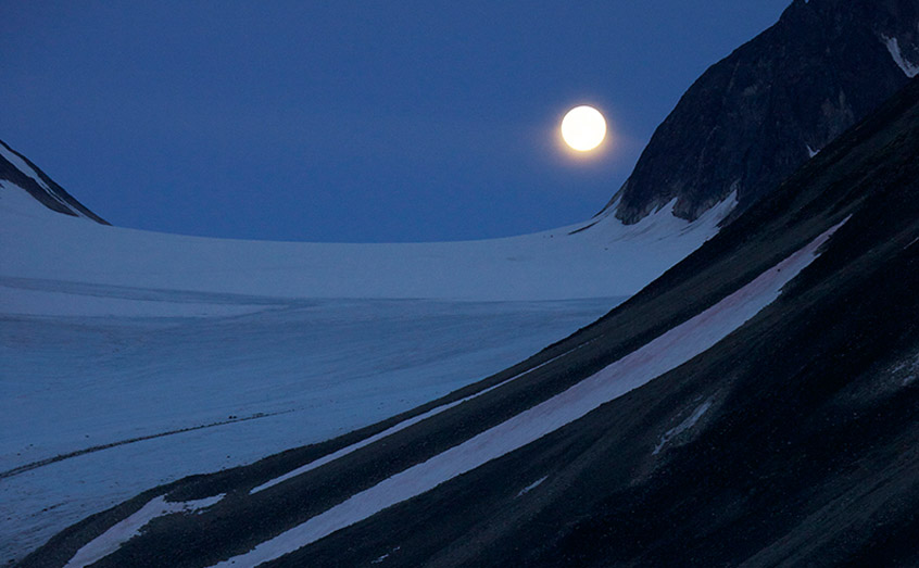 The moon rises over the Arctic during the polar night
