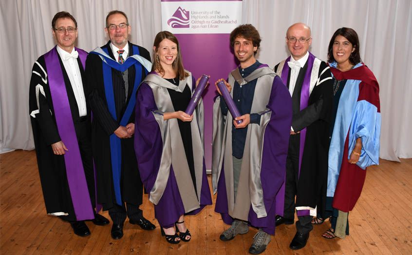 The first two PhD graduates from the University of the Highlands and Islands, Dr Winnie Courtene-Jones and Dr Andrea Garvetto are congratulated by, from left: University of the Highlands and Islands Dean of Research Michael Rayner, SAMS UHI Director Prof Nicholas Owens, university Vice-Principal Prof Neil Simco and Head of SAMS UHI Graduate School Dr Bhavani Narayanaswamy.