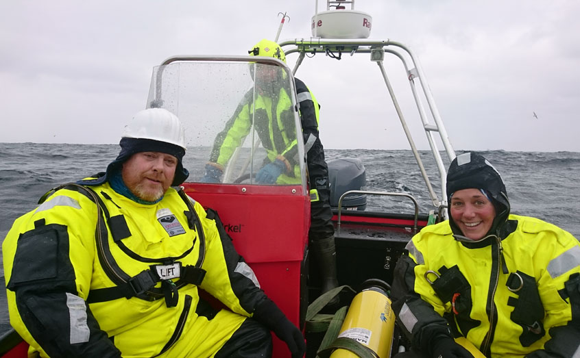 Prof Jorgen Berge, UiT and Dr Emily Venables, SAMS retrieve a glider from the Barents Sea during the Arctic PRIZE April cruise