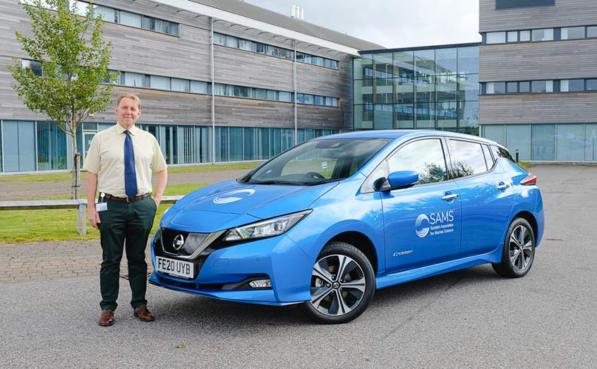 SAMS Deputy Director Prof Axel Miller takes delivery of the new electric car