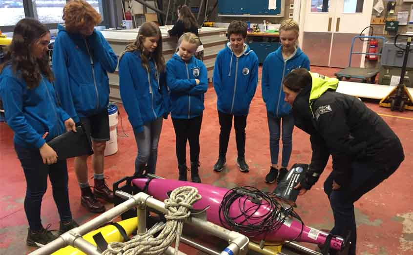 Dr Emily Venables lets the Ullapool Sea Savers see marine robotics at close hand during a tour of SAMS