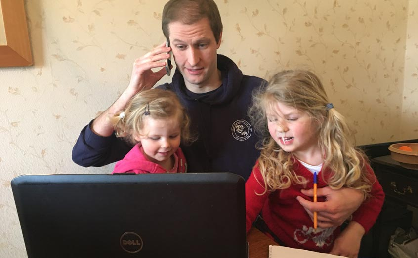 SAMS communications and media officer is joined by his daughters during a video conference from home
